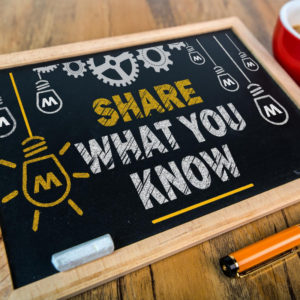 "A chalkboard that says ""share what you know."""