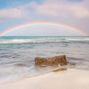 Double rainbow over the ocean.