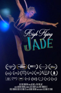 """Movie Poster for 'High Flying Jade."""" It features medium shot of woman holding a hoop. It also lists many awards won by the film."""