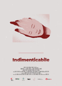 Movie poster for the film 'indimenticabile.' It features a drawing of a hand in which drawing of a face is visible.
