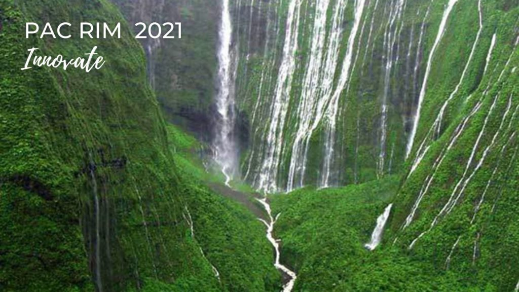 "Photo of Waiʻaleʻale on the Island of Kauaʻi. There is a mountain with lush green vegetation and several white waterfalls. In the left upper corner it says ""Pac Rim 2021 and Innovate."""